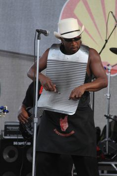 """Rockin Dopsie J  """"When Rockin' Dopsie, Sr. unexpectedly passed away in 1993, the Dopsie family vowed to keep his memory alive, mainly in the incarnation of this band, Rockin' Dopsie, Jr. & The Zydeco Twisters. In doing so, it's become its own phenomenon. No other zydeco band has ever been fronted by a washboard player. It's usually the accordionist, and it's also a safe bet that there's never been such a flamboyant personality as Rockin' Dopsie, Jr."""