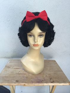 For expedited shipping send me a message!  Snow White Wig Parks Style Version 2 Adult Costume Wig   This is a beautiful Jet black costume wig! Made to portray Snow White in the style currently in the theme parks! If you have a specification of wanting the style changed a little bit for a different character let me know and i can make it more to your liking!    I will ship this USPS priority mail 2-3 day shipping with Tracking and Insurance! The Wig will be shipped very carefully on a…