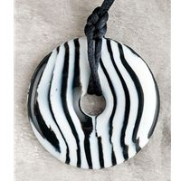 Black and White Teething Necklace. These Teething Bling products are made from a food-safe, phthalate-free, federally-approved silicone.    Safety-reminder: these pendants are intended for adults to wear. Please do not place the pendants ON your child.  #teethingbling #teething #necklace #myurbantoddler #jewelry