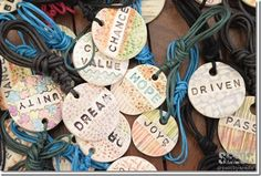 Each of her handmade clay pendants has words of encouragement meant to give inspiration and hope for the wearer.