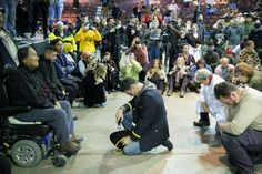 JOSH MORGAN FOR THE HUFFINGTON POST Wesley Clark Jr., middle, and other veterans kneel in front of Leonard Crow Dog during a forgiveness ceremony at the Four Prairie Knights Casino & Resort on the Standing Rock Sioux Reservation on Monday.