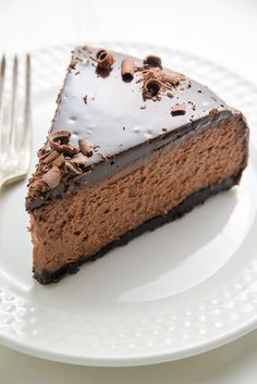 Oreo Crusted Chocolate Cheesecake topped with Chocolate Ganache and spiked with Kahlua… need I say more?!