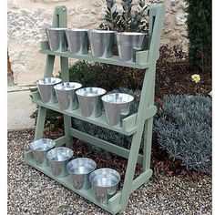Plant display! I love how simple it is and keeps everything in one place. what about rusty buckets though...maybe rust proof spray paint.