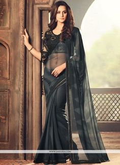 Genuine splendor comes out as a outcome of the dressing style and design with this black faux georgette classic designer saree. Beautified with embroidered and lace work all synchronized effectively t...