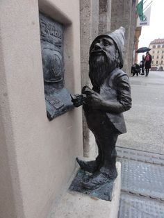 Tiny gnome statues appear everywhere in #Wroclaw, Poland. Every major attraction, old back street and even shopping mall has a dwarf, each with a name. This one withdraws money at a tiny ATM.