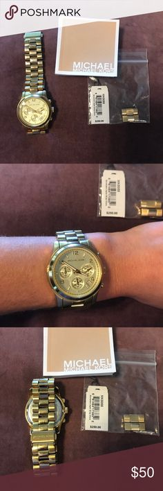 Michael Kors Gold Watch Midsized Chronograph Gold Tone Women's Watch 37 mm. Style MK 5055. Slight wear and tear on the back of the wrist, needs battery, but otherwise in great working condition. Comes with book, extra links, and the original upc/ retail tag. Authentic, Originally purchased at Macy's. Michael Kors Accessories Watches