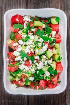An easy Mediterranean watermelon salad with cucumbers and feta cheese. Fresh mint and basil leaves and a honey vinaigrette add great flavor! 10 mins!