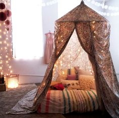 DIY a corner canopy with sheets and a hula hoop. Add string lights and as many pillows as you can find.