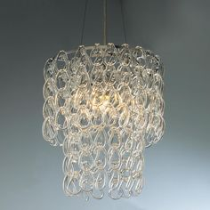 Round Glass Chain Chandelier Glass links hang delicately from a chrome rim deflecting light in every direction, making your room sparkle with beautiful light effects