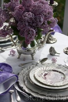 purple heaven. love the silver tea pot for the vase.