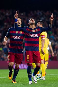 Neymar Santos Jr of FC Barcelona is congratulated by his teammate Luis Suarez after scoring his team's fifth goal during the La Liga match between FC...