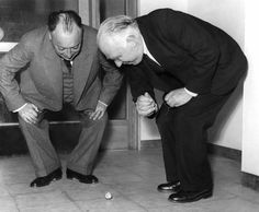 Two Nobel Prize winning physicists Wolfgang Pauli (left) and Niels Bohr (right) playing with a Tippe Top.