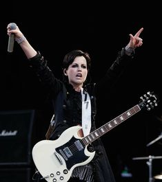 Dolores O'Riordan of The Cranberries performs on stage during day one of Feis Festival 2011 at Finsbury Park on June 2011 in London, United Kingdom. Instrument Music, Music Instruments, Guitar Hero Game, Dolores O'riordan, Finsbury Park, Cranberries, Singer, Actresses, Band
