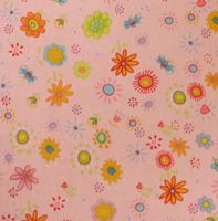 This is a high quality woven cotton print featuring multi-colored flowers on a pink background.  It is part of the Cuddle Me collection by Becky Kelly.  by Timeless Treasures