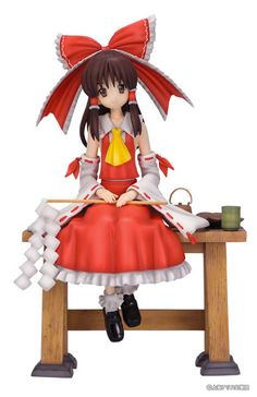 Reimu Hakurei is the protagonist of the hugely popular game franchise from Team Shanghai Alice, *Touhou Project*! Normally she's busy solving all the supernatural problems which arise in Gensokyo, but here she is having a bit of a well-deserved rest! Dressed in her usual red *miko* or shrine maiden's outfit, she's sitting on a wooden table next to some tea and delicious-looking snacks. Why not tak...