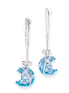 A PAIR OF BLUE TOPAZ AND DIAMOND EARRINGS