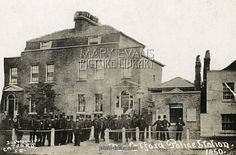 Catford Police Station in south east London with officers posing outside. Date: 1850