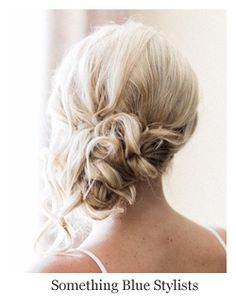 Classic bridal hairstyle low messy chignon bun.~ Hair by Something Blue Stylists - A Hair Comes the Bride affiliate stylist.