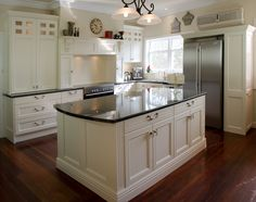 Love the stunning bespoke doors & farmhouse style stove alcove by Let's Talk Kitchens with Allan Aitken