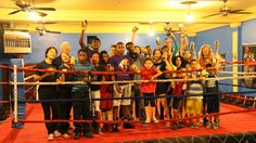 The young people of Crushers Club hanging out in the boxing ring with Garrett Popcorn!