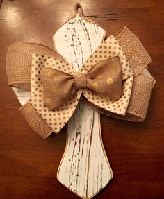 A personal favorite from my Etsy shop https://www.etsy.com/listing/400858543/white-wood-cross-w-tan-gold-ribbon