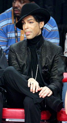 Enjoying an All-Star basketball on Feb. 18, 2007 in Las Vegas, Prince goes all-black -- from his shoes, to his shiny jacket, to hit tilted hat.