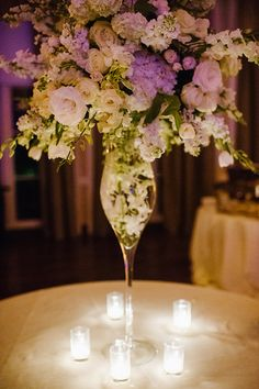 All white flowers by Artfully Arranged with lighting affecting colors-Photo from Capps Wedding collection by Caroline Lima Photography