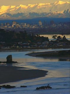 pre quake...... Shag Rock is still standing and there is still city buildings in the background..... Christchurch, NZ