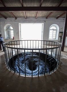 anish kapoor's black water vortex spins endlessly into gallery floor