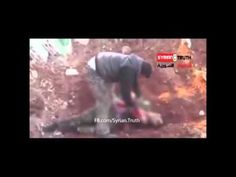 Syrian Rebel Cannibalises Government Soldier ...... And we are going to arm these people. !!!