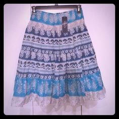 """Chaps skirt Chaps Denim Santori skirt in women's size 16. Beautiful shades of blue make up the shell's floral paisley pattern. Shell is 100% cotton. Fully lined, off-white, 80% polyester and 20% cotton.  Length is 25"""" (shell) and 23"""" (lining). Brand new and never worn. NWT.  Perfect for spring and summer! Chaps Skirts A-Line or Full"""