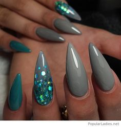 Long stiletto nails with blue glitter