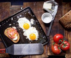 A toast to Saturday morning!  with tomatoes cheese and sunny side eggs on the Mini! #bakingsteel #feedfeed #breakfast #mini by andrislagsdin