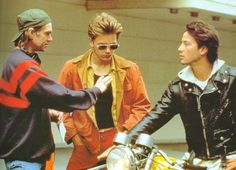 Gus Van Sant, River Phoenix and Keanu Reeves while filming 'My Own Private Idaho' in 1991.