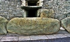 """The triskelion or"""" triskele"""" is also known as the tri-spiral or """"Spiral of Life."""" The three spirals in the triskelion are interconnected with no open ends thus creating one continuous line. Each spiral turns in the same direction. This symbol is found on many ancient carvings, the most famous of which is Newgrange in County Meath, Ireland, which dates back to 2500 BC. The symbol is carved into the rock at the main entrance. It is one of the most famous stones in Megalithic art."""