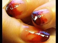 This video shows the viewer how to paint their nails to give them a blood stained look for Halloween. This is done by first putting a small amount of dark red nail varnish onto a sheet of paper. Then apply this in many coats to the nail using a foundation brush to give a layered effect. Then place a small amount of black nail varnish on the paper and using the same section of the foundation brush apply some of the black nail varnish to the ends of the nails. Then apply some of the red…