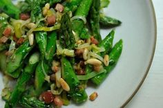 absurdly addictive asparagus: pancetta, leeks, garlic, citrus and pine nuts