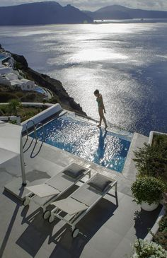 Dip in your private pool and enjoy the view of the Aegean from your suite at Santorini Secret