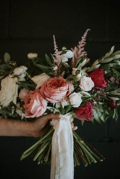 Pink wedding bouquet with silk white ribbon | Image by Olivia Strohm Photography