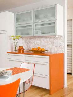 Add some energy to your kitchen by adding bold pops of color! More colorful kitchen cabinetry: http://www.bhg.com/kitchen/cabinets/styles/colorful-kitchen-cabinetry/?socsrc=bhgpin061713orange=15