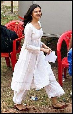 Need a similar white pallazo with a kurta shirt like Deepika Padukone is wearing Indian Fashion Dresses, Dress Indian Style, Indian Designer Outfits, Pakistani Dresses, Indian Outfits, Fashion Outfits, Salwar Designs, Kurti Designs Party Wear, Indian Attire
