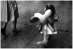 Gary Winogrand - In this piece, I feel that Winogrand captured the simplistic element of childhood.  This image for me is very successful.  I feel that because he didn't include the little girl's face, just the balloons was perfect because it simply speaks the truth and is to the point.  Very striking.