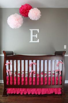 Baby Nursery : Baby Girl Nursery Handmade Red Soft Pink Pom Poms Tissue Paper Wall Accesories Dark Wood Crip Wood Floor Laminate White Bedding Pink Quilt Simple and Easy to Apply Baby Nursery Ideas Simple Baby Nursery Idea. Baby Nursery Design. Simple Baby Nursery Ideas.