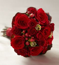 The FTD® Heart's Promise™ Bouquet is an expression of true love and rich romance. Red roses, spray roses, carnations, hypericum berries and ...