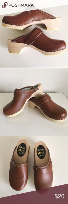 ADORABLE Vintage Brown Leather Clogs Size 6 ADORABLE Vintage Brown Leather Clogs with Wood Sole. Listed as size 36. Converted to Size 6. Made in Sweden! Excellent craftsmanship & quality. One tiny knick on right strap (see last photo) & marked out writing on the bottom of the shoe. Otherwise, superb condition. Vintage Shoes Mules & Clogs