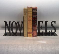 """$22 """"NOV-ELS"""" bookends. (I've decided I want to organize [some of] my books according to these adorable bookends)."""