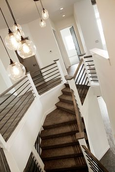 Looking for Modern Stair Railing Ideas? Check out our photo gallery of Modern Stair Railing Ideas Here.