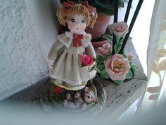 Bambolina con rose pasta di mais.