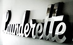 11thT or 21stM/Steel or Nickel-Launderette 3D Chrome Sign by Goodwin + Goodwin.  That would be one nice laundry room!  $2014.65
