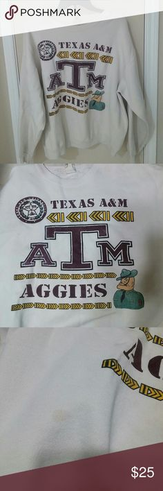 Vintage Texas A&M Swearshirt XL but I think it fits a M/L. This thing is from the 80s so there are stains but no holes or tears anywhere. Great for cold game days. Sweaters
